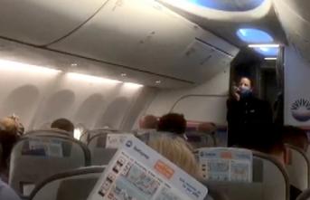 İzmir'den dönen AKUT ekiplerine uçakta alkışlı karşılama